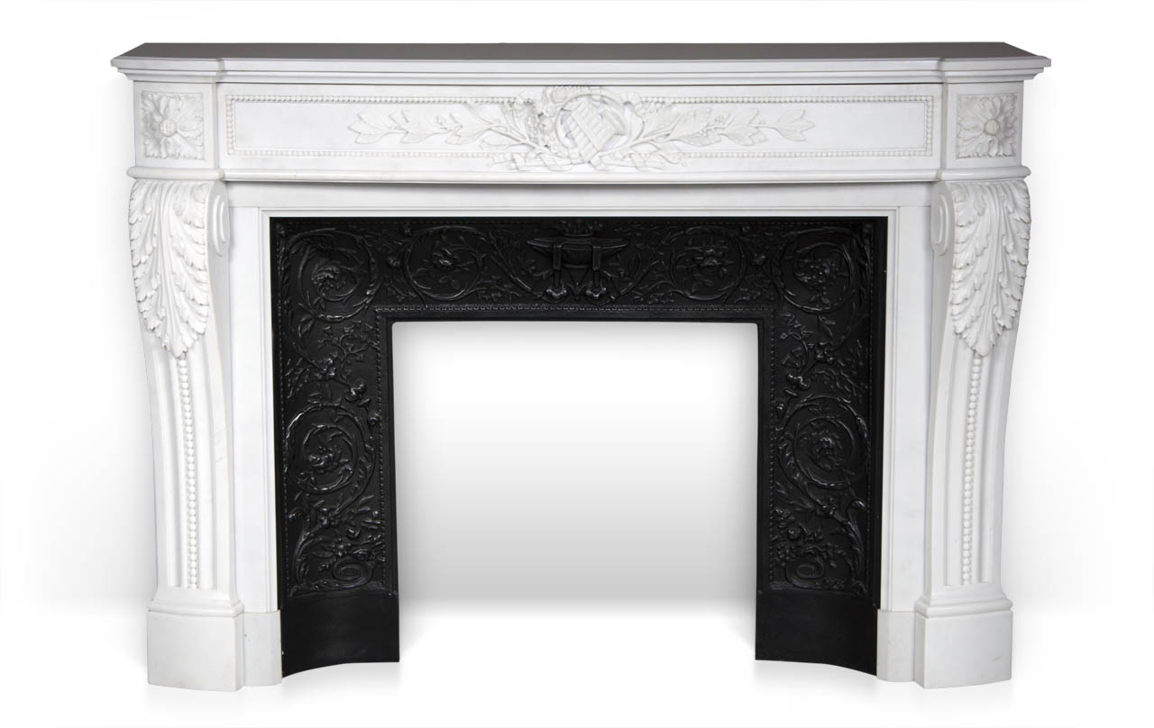 Arcadia is a custom-made Louis XVI style fireplace mantel made out of marble, with a curved entablature and with a pan flute and floral carving.