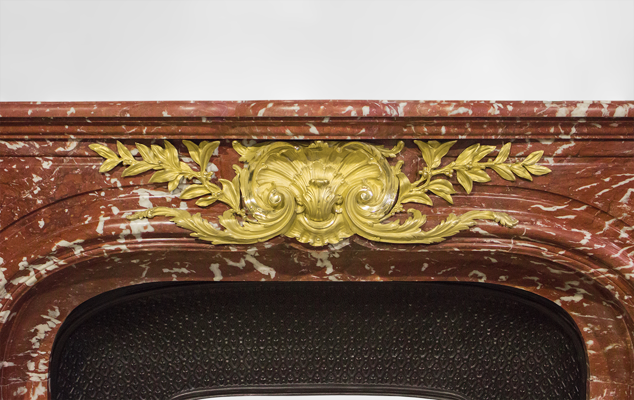Maison & Maison, marble designer presents his custom-made Louis XIV style fireplace mantel, Grand Siècle, made out of marble, with lions heads in gilded bronze