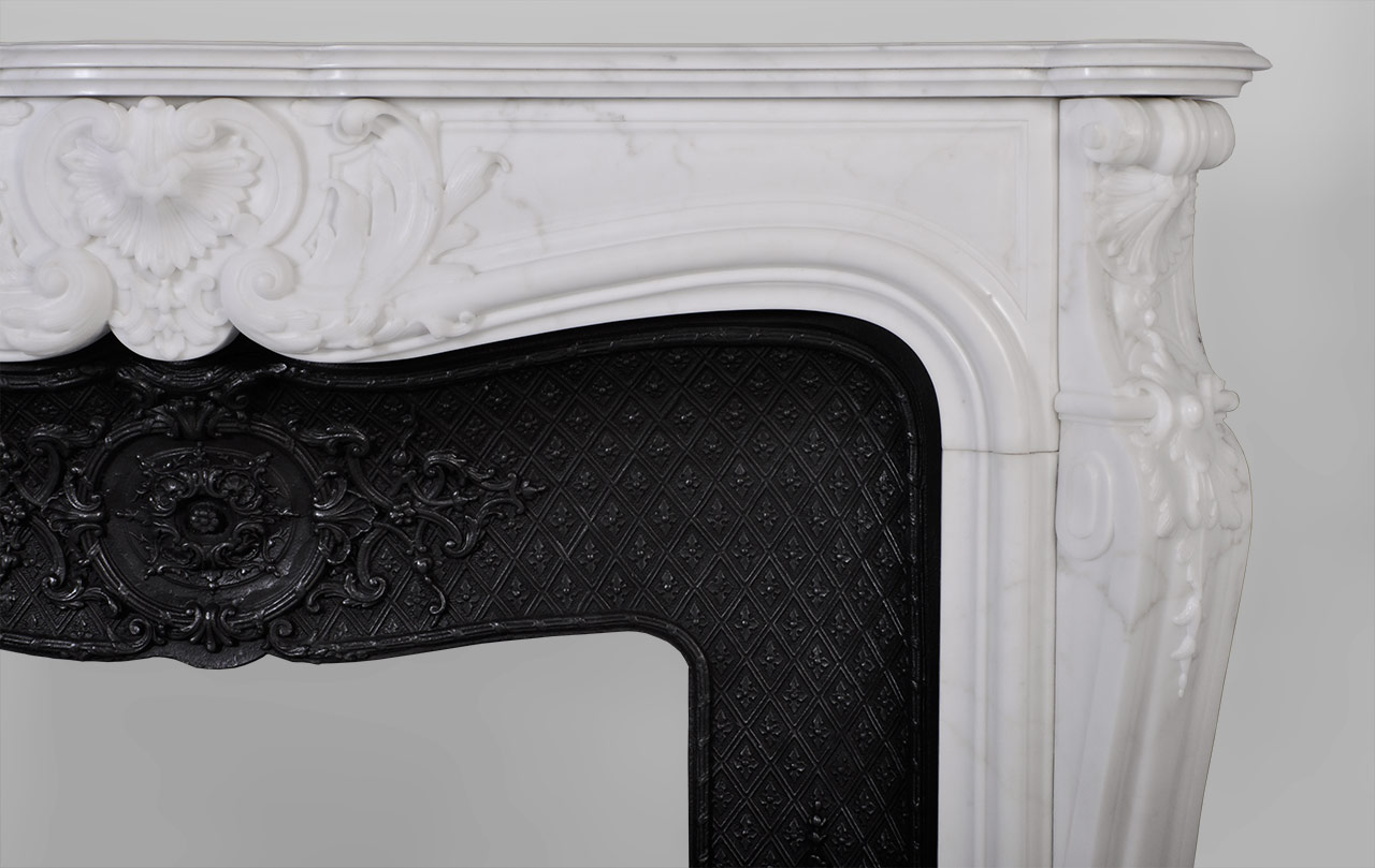The Hotel de Lassay mantel is a custom-made mantel with a richly carved decor characteristic of the Louis XV style.