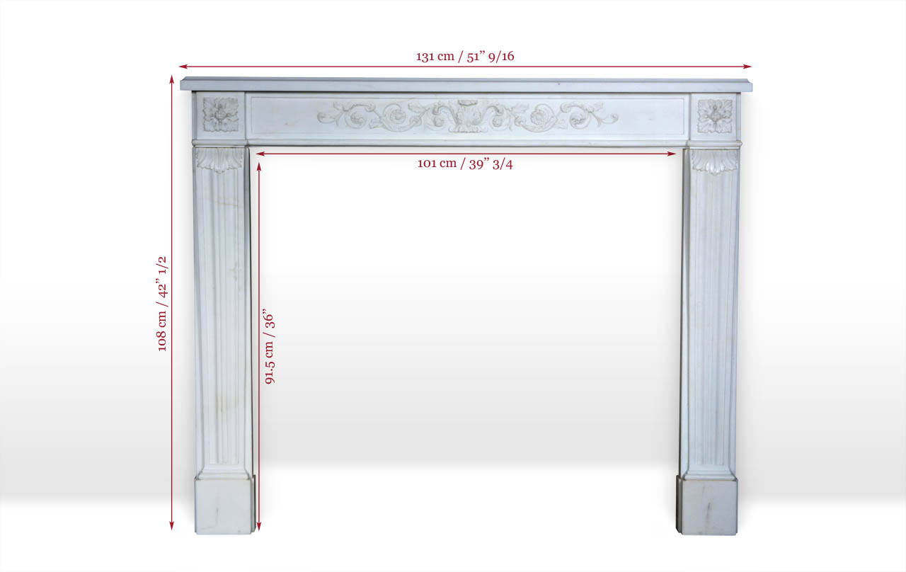 Marquis de Condorcet is a custom-made marble fireplace mantel with an entablature carved in low relief with volutes and vegetal scrolls.