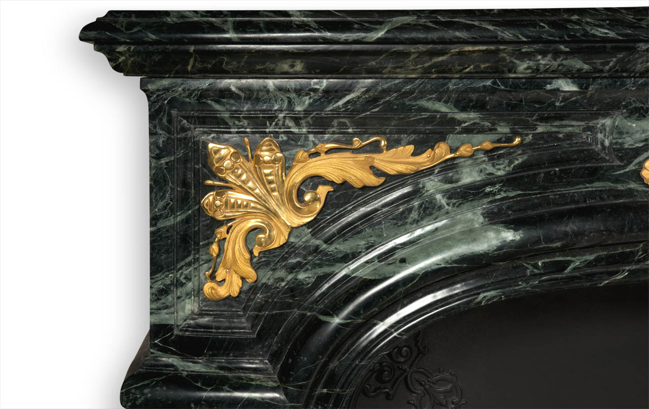 The Noailles fireplace is a highly sophisticated custom-made Regence style model made out of marble with gilded bronze ornaments.