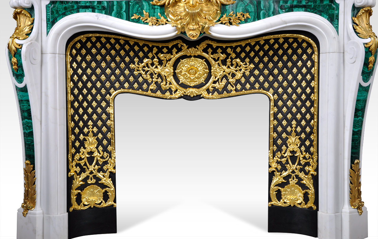 Païva is a superb custom made marble fireplace of Louis XV style with gilded bronze ornaments and exceptional malachite inlays.  Manufactured by Maison & Maison.