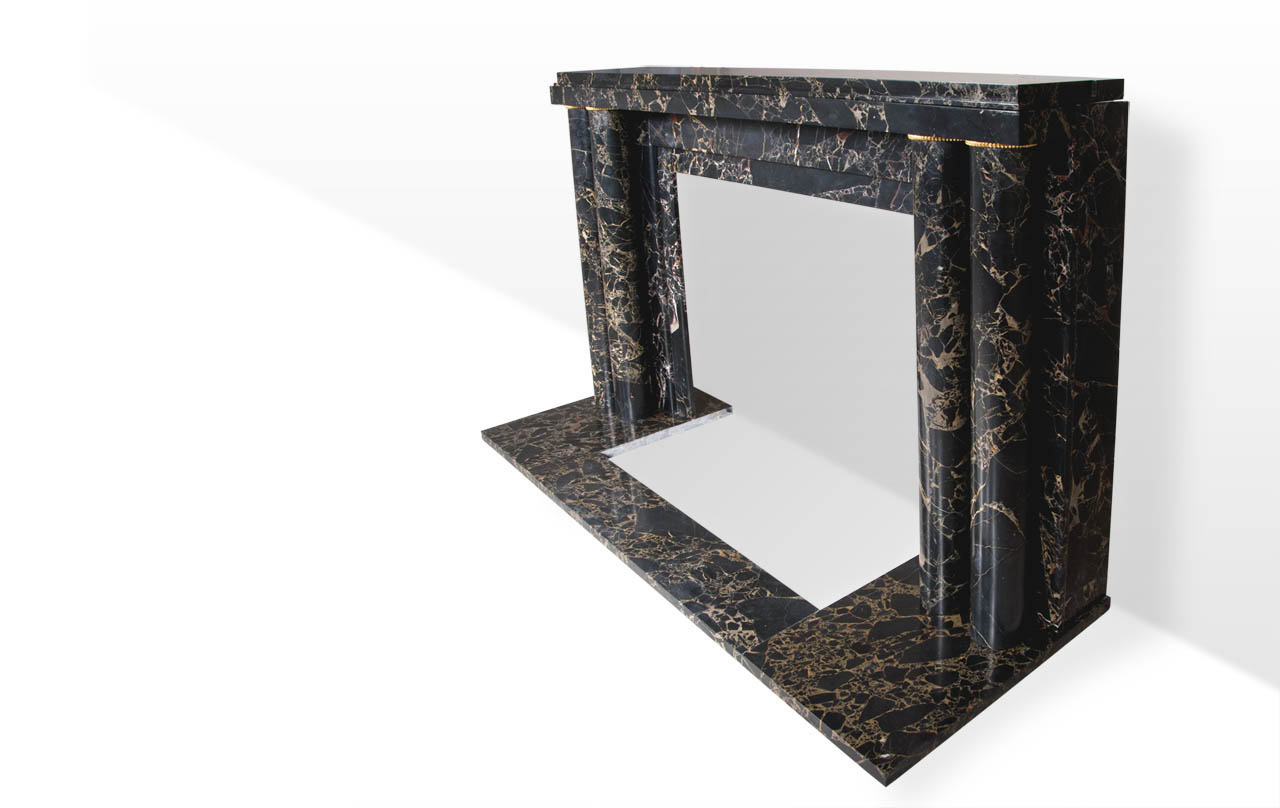 Paquebot is an Art Deco style custom-made marble fireplace decorated with a pair of double columns with gilded bronze fluted rings.