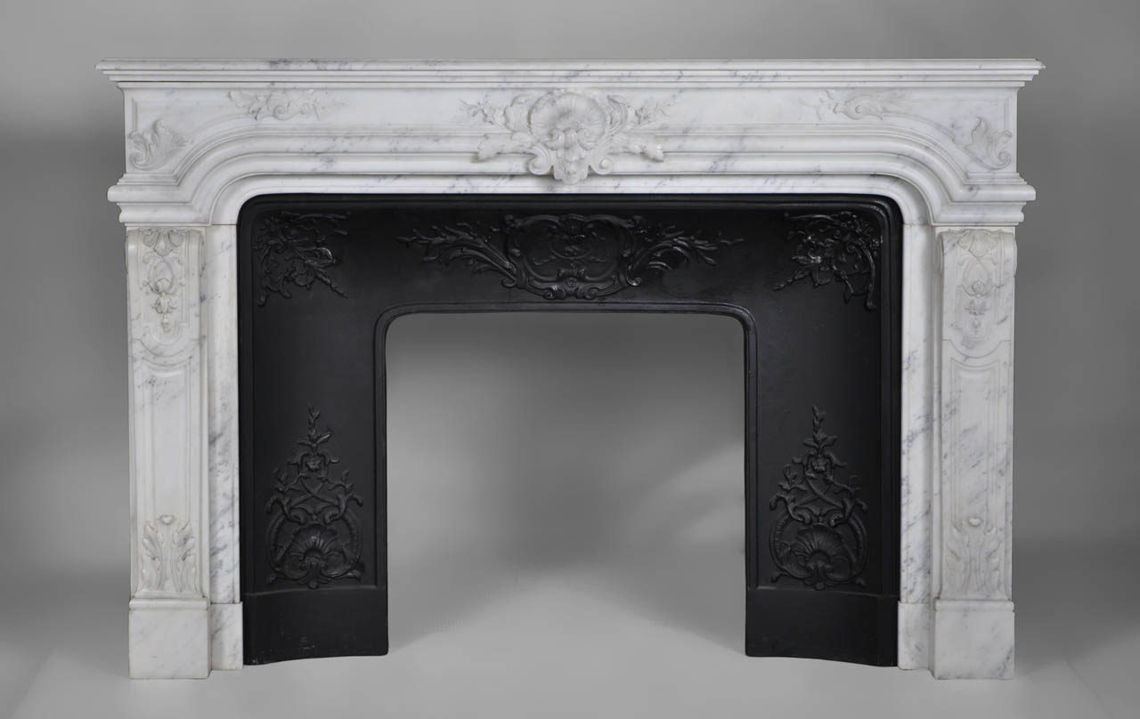 """Vendome"" is a Regence style mantel made out of white Carrara marble that combines both sophistication and elegance.
